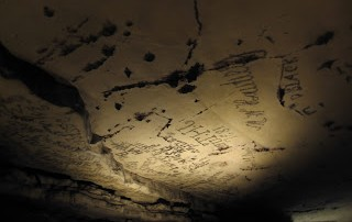 candle smoke writing in Mammoth cave