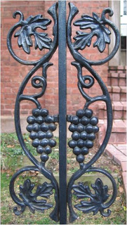 black wrought iron fence with grape motif