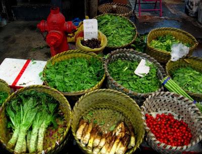 baskets with green herbs in Nanshi market Shanghai
