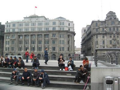 Group of people on Bund boardwalk taking a break