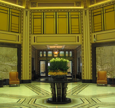 Yellow and green Art Deco lobby of the Peace Hotel in Shanghai