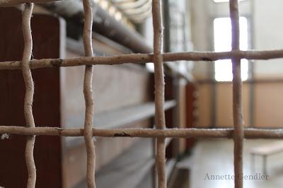 View through prison bars at library in Alcatraz