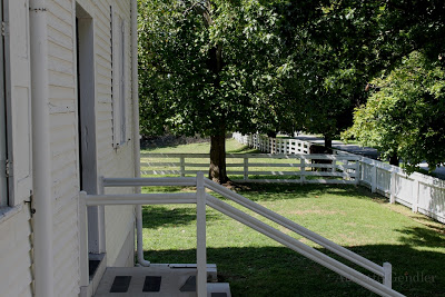 Shaker village white clapboard house and steps