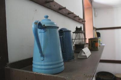 blue enamelware jug with spider web at Shaker Village