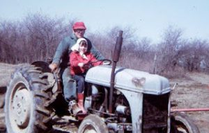 annette-grandpa-on-tractor-1971-cropped