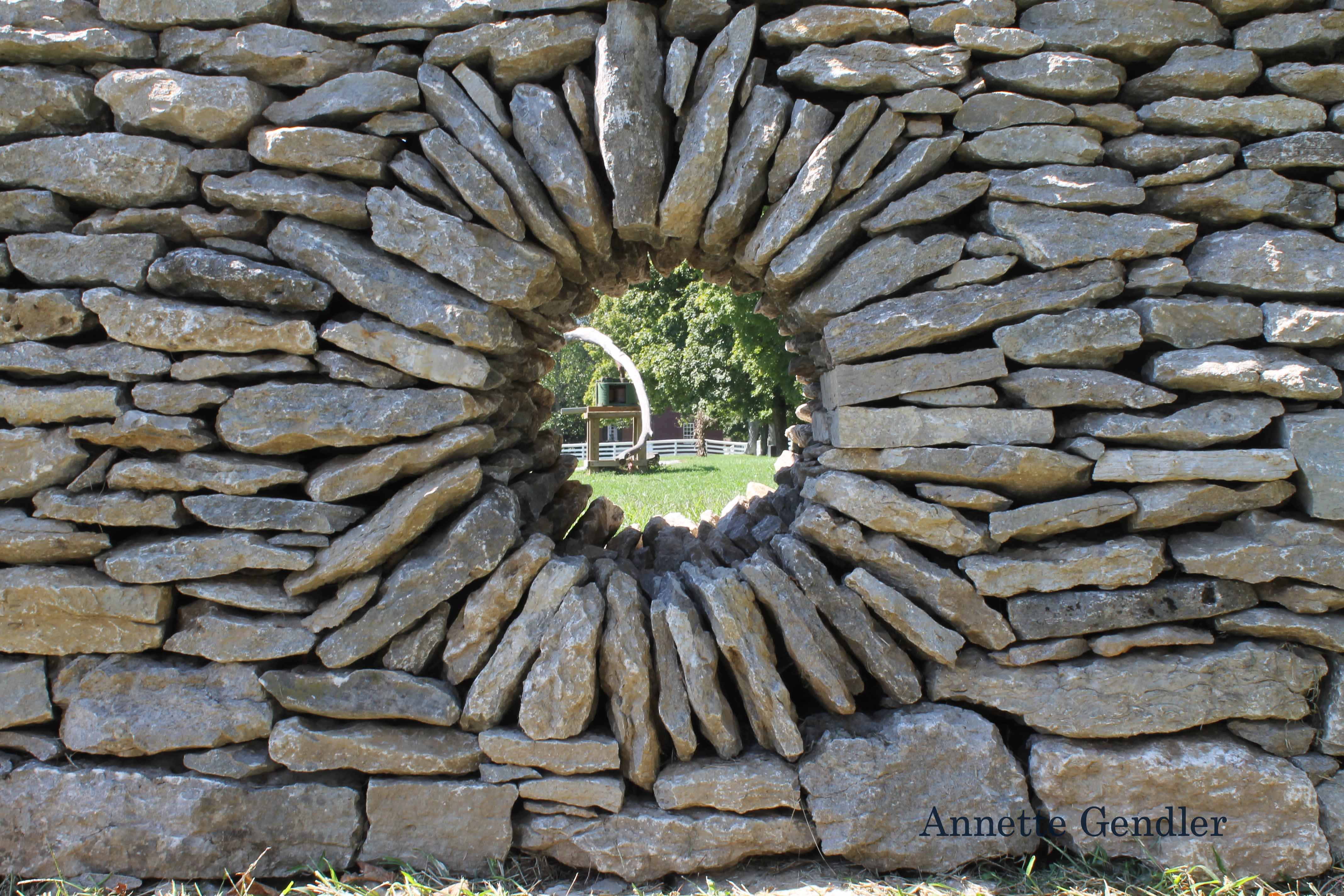 hole in stone fence