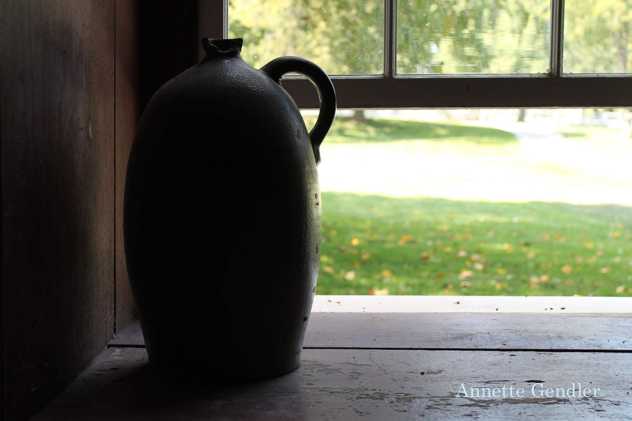 earthenware jug on window sill