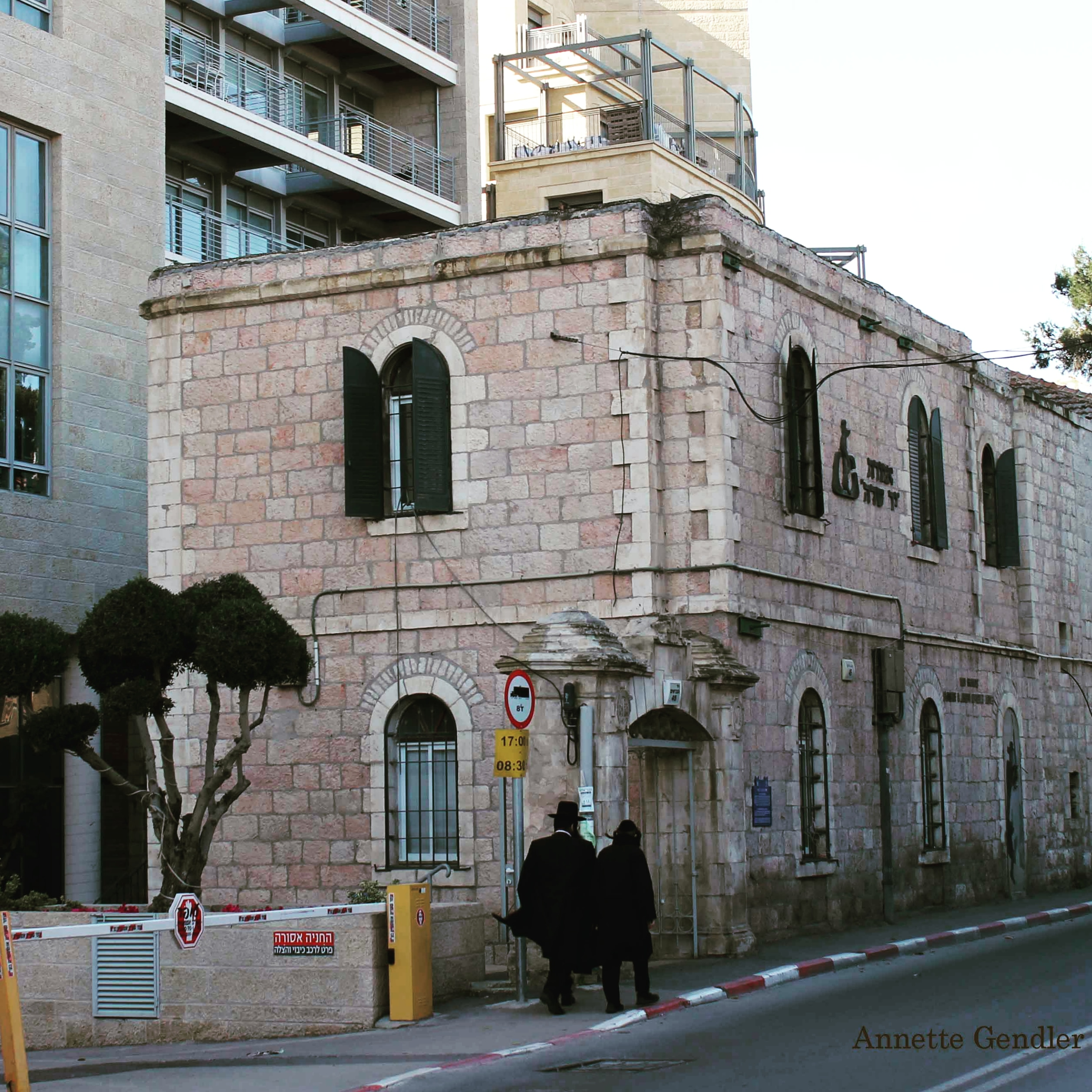 19th century two story building in front of a modern apartment complex on Ha Nevi'im Street in Jerusalem