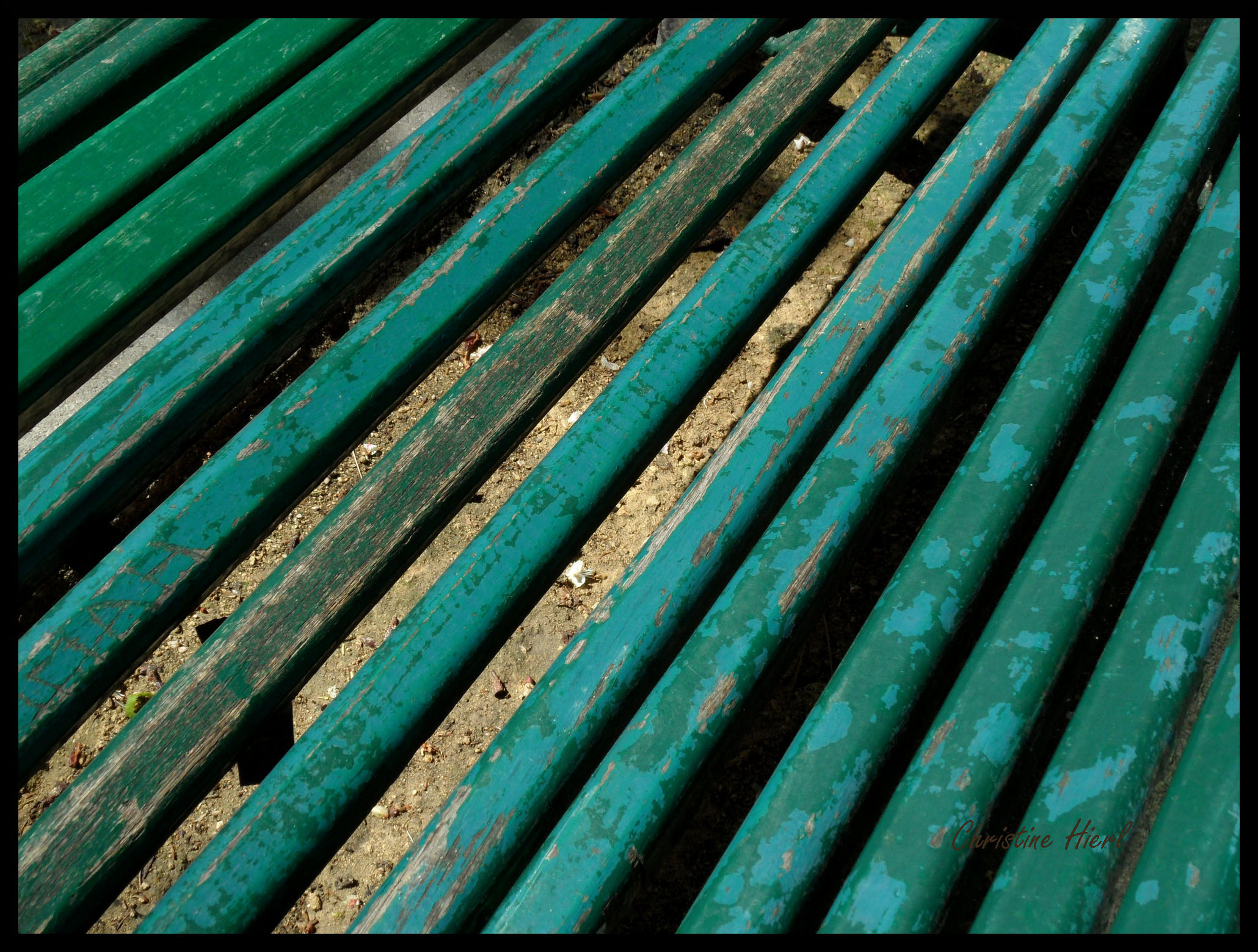close up of slats of old green bench in Parc Montsouris, Paris