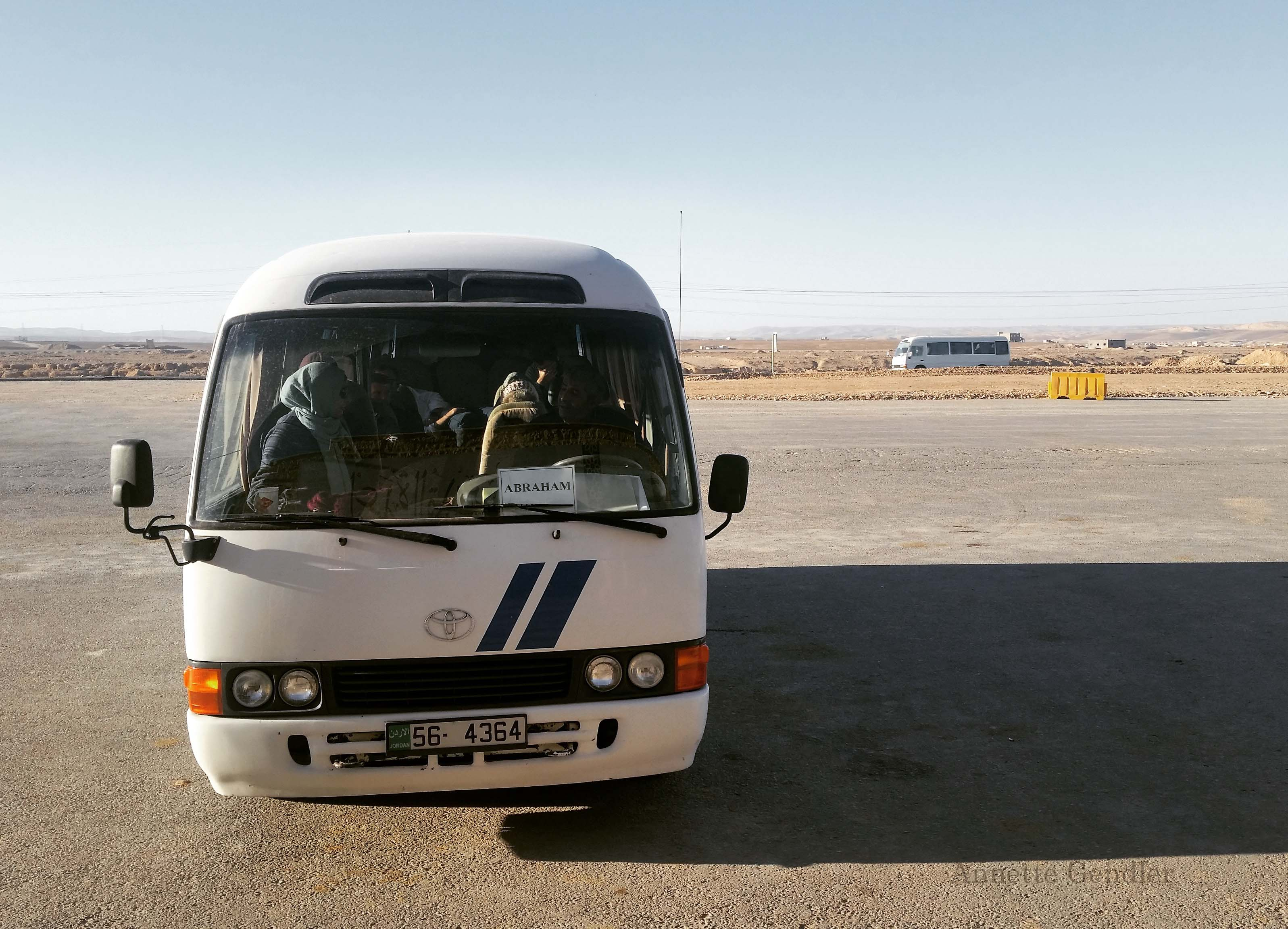 small tour bus shown in Jordanian desert