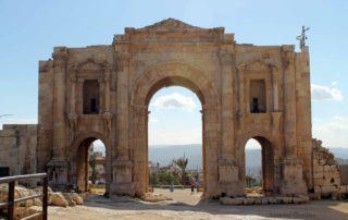Hadrian's Arch in Jerash, Jordan against a blue sky