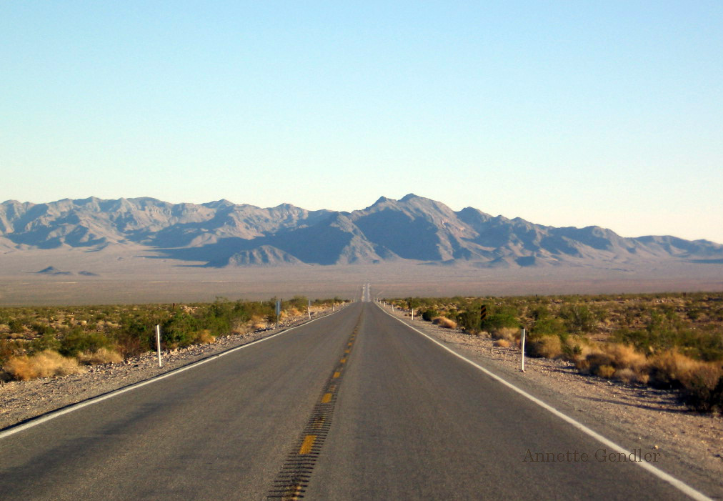Get going on the road to writing, just as on this empty paved road leading into the distant mountains in Nevada