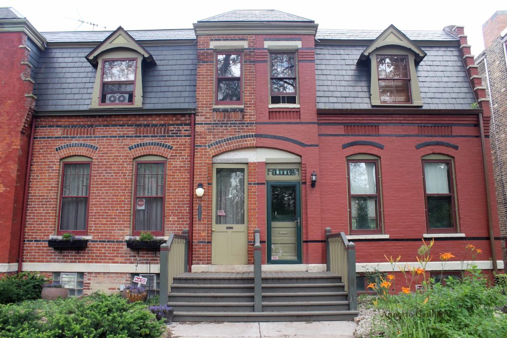 frontal view of two red brick row houses in the Pullman Historic District