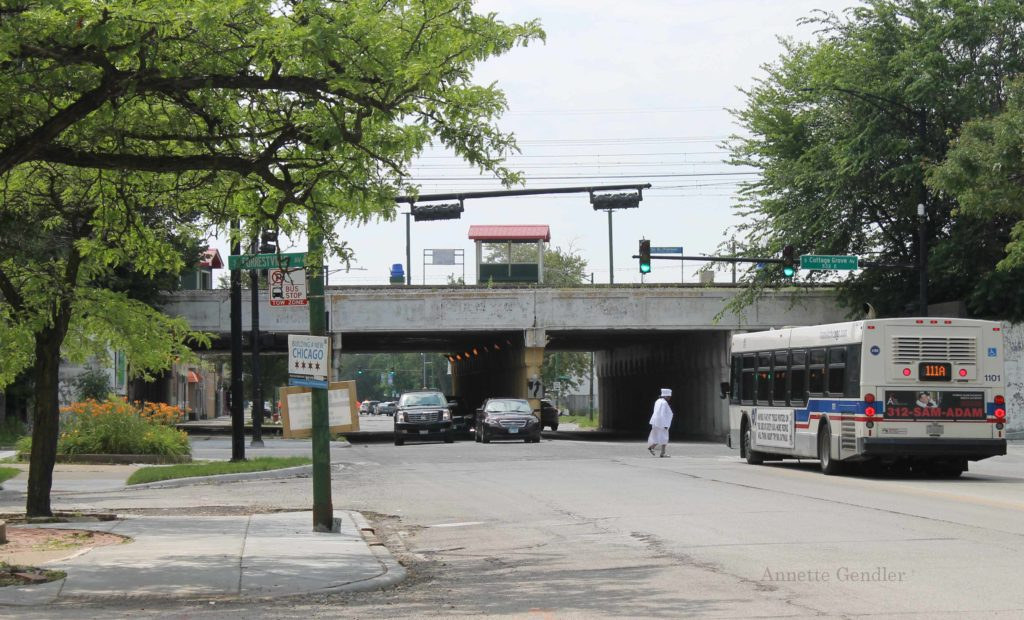 111th Street Underpass with Metra Station, bus in the foreground