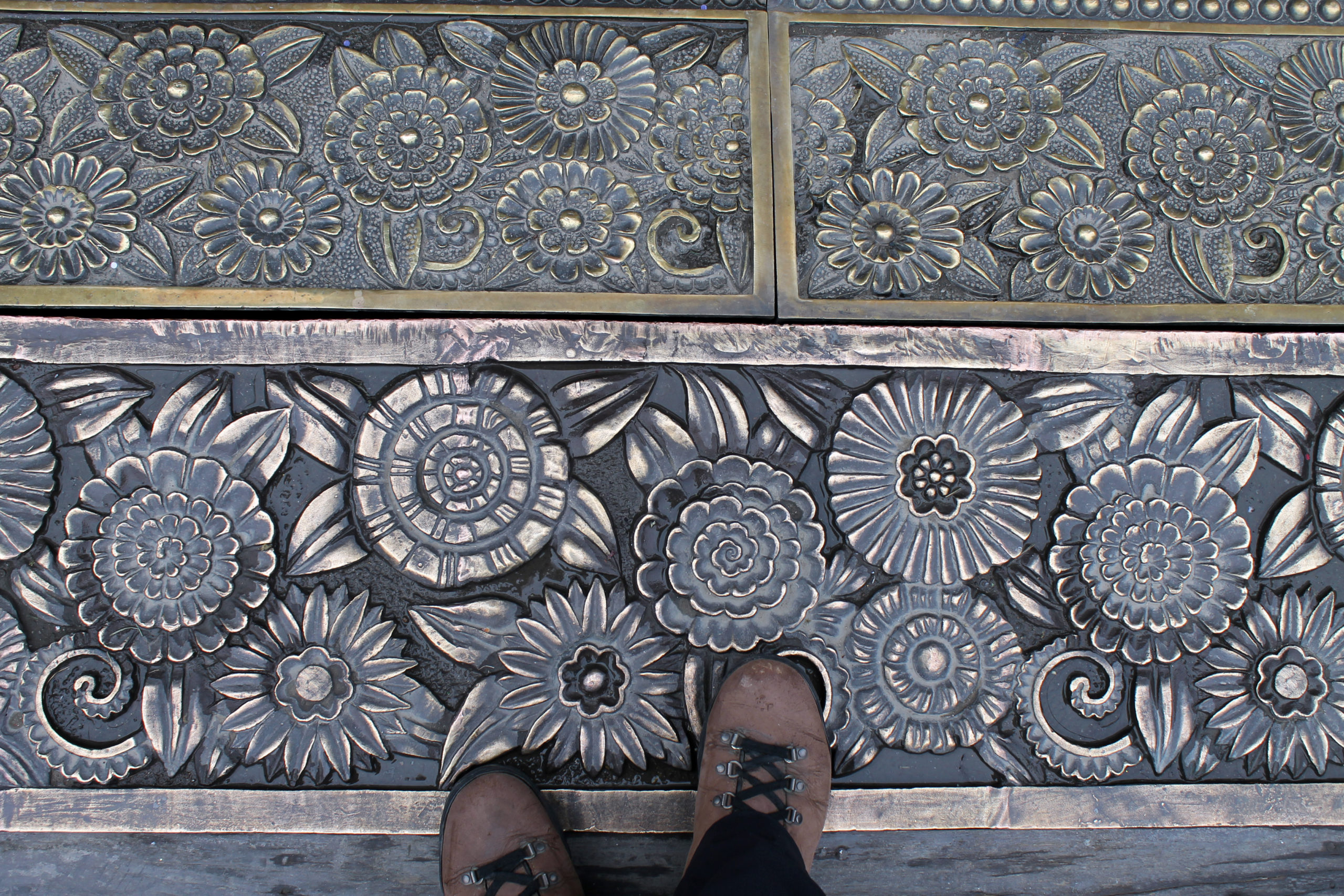 Hiking books viewed from above on ornate floor