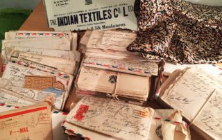 pile of letters with handwriting addresses sent from India to the U.S during WWII