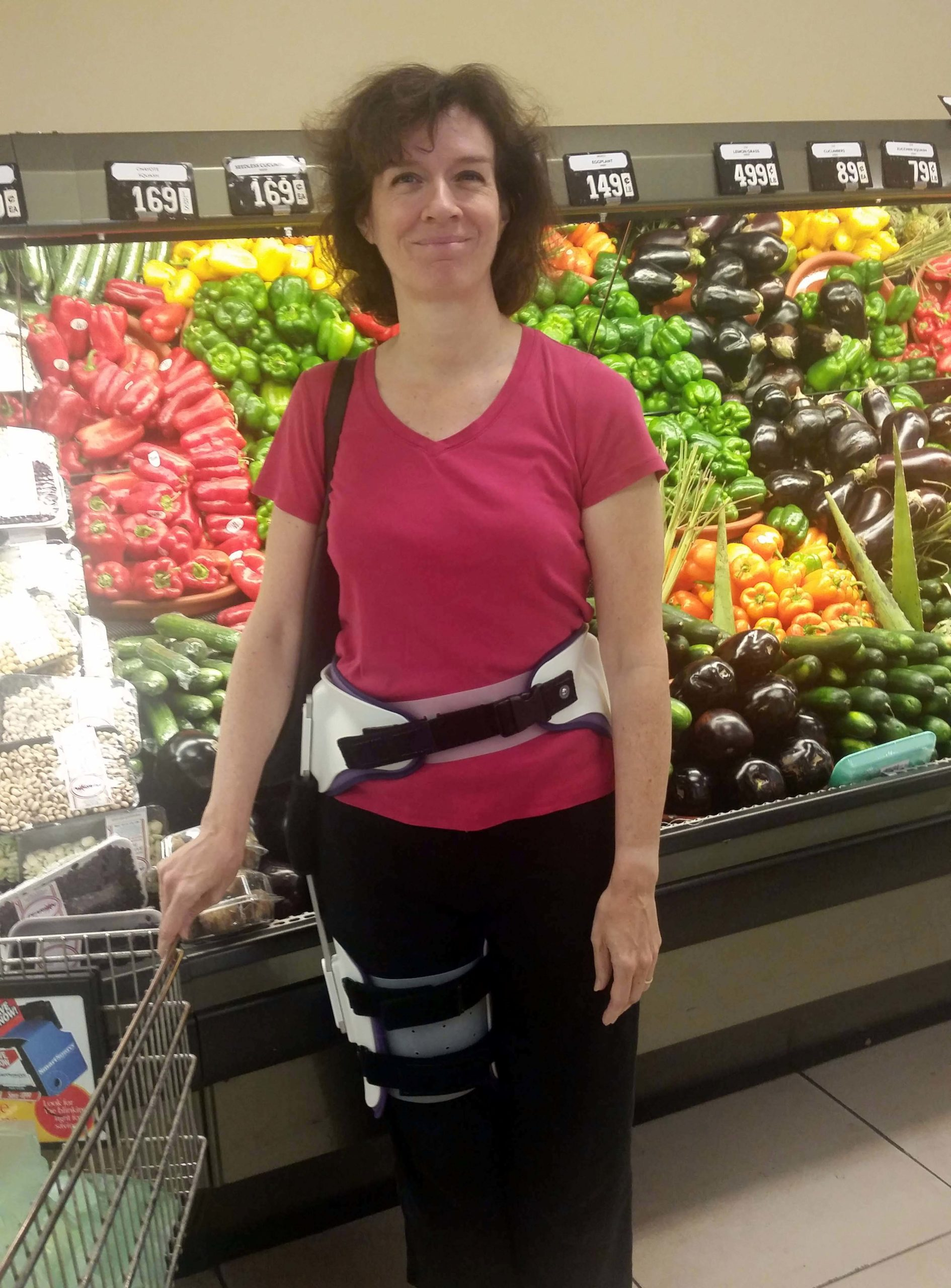 Frontal view of woman wearing the body brace prescribed after hip labral tear surgery