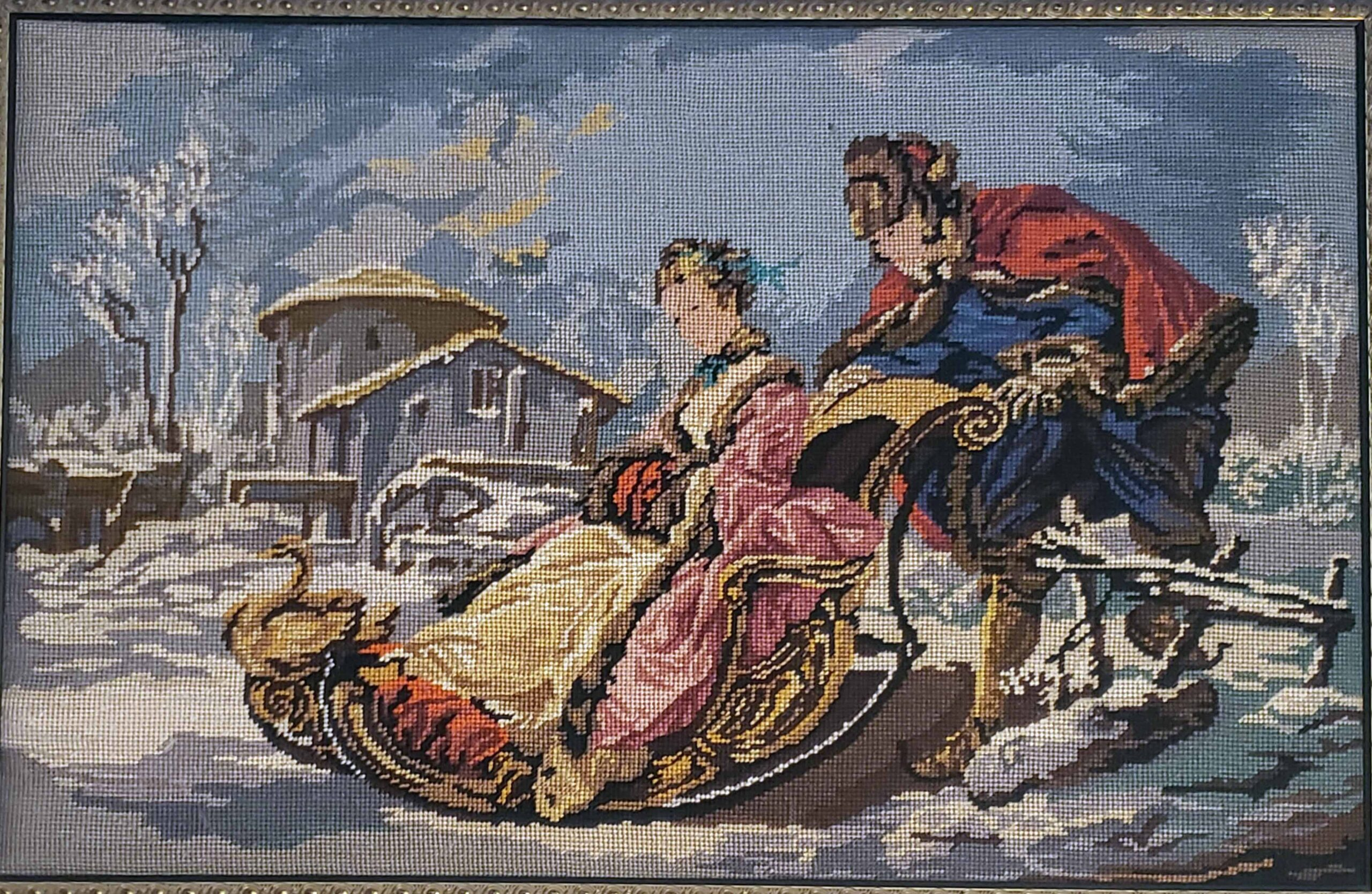 tapestry showing a winter scene of a man pushing a woman on a sleigh