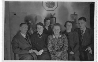 family group picture black and white, dining room, 1940s, Czechoslovakia